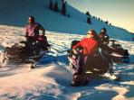 Snowmobile tours will pick up your group near the home