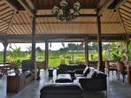 OUTDOOR LIVING AREA, OVERLOOKING GARDEN AND POOL WITH SWEEPING VIEWS OF RICE FIELDS AND MOUNTAINS