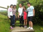 Well Cottage Cornwall recent guests from Hong Kong with our goat Blossom