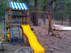 Kids enjoy our treehouse playset, and the sandbox in a boat!
