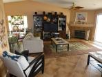 Great Room facing entertainment center with 50' flatscreen TV and stereo