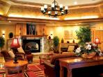 Enjoy the hotel lounge and fireplace