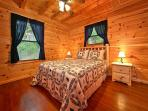 Cabin has a huge 2 person shower. Relax on the wooden rocking ch