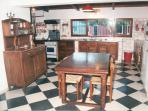 Large and well equipped country kitchen with fireplace. Amplia cocina de campo.