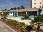 Cute, brightly colored beach cottage with new landscaping