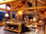 The Great Room is highlighted by a massive stone woodburning fireplace
