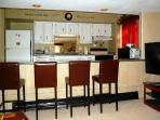 Full Kitchen with seating for 6, coffee maker, microwave, toaster oven, food processor, baking itmes