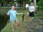 Uncle Bart catching fish in the pond in the backyard