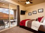 Queen Bedroom upstairs with balcony overlooking golf course