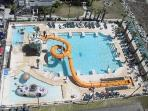 Kids are sure to love the water slide and splash area at nearby Caribbean Resort!