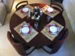 Dining table set for four.