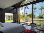 Luxurious bedrooms with views over the Batu Jimbar estate.