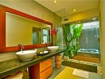 Bathroom with rain shower with outdoor access to jacuzzi