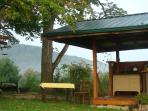 Kitchen pavillon has everything you need to make and enjoy meals.  A few steps from covered porch.