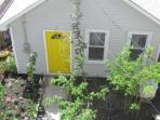 entrance to the coach house thru the garden