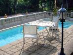 Enjoy the pool area located in the park / garden areas of the Chateau des Sablons.