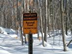White Mountain National Forest boundary sign - marks the beginning of the backyard playground. -