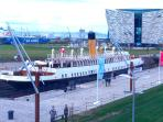 Titanic Belfast and Restored Titanic 'Taxi' boat