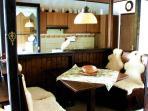 Dinig room, kitchen behind