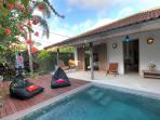 The tropical garden and private swimming pool at Villa 007.