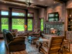 Stone fireplace, rich woods, large screen TV