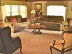 Vacation Cottage living room, comfortable w/windows to overlook creek and woods.