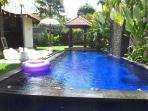 Pool with waterfall in a peaceful garden