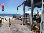 Cool modern beach bars and restaurants abound