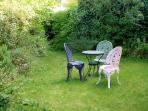 The pretty back garden is secluded and peaceful.