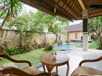 Beautifull garden with swimming pool. The veranda of Kama room