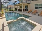 Screened heated pool and spa with loungers
