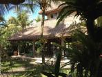 The main house in high sun with coconut palms