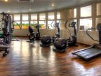 Gym with free weights/benches/universal machine/cardio equipment