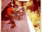 Our garden - breakfast with our guests and one of the dogs.