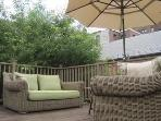 Roof deck w/ very large and plush outdoor sofas