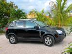 In combinatie te huur: Chevrolet Captiva Sport SUV met airco.