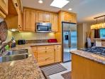 Kitchen has high end touches and is fully equipped