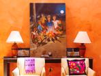 Historic charm and original Mexican art decorate the spacious living room.