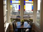 Dining Area is Surrounded by Oversize Original Windows Complete with Downtown Views.