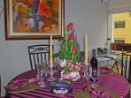 Dining Table w/Flowers, Danish cookies, Peruvian wine