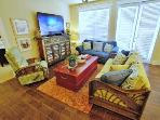 Living room with 60' HD-LED Smart TV with Blu Ray