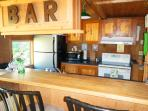 What cabin is complete without a bar and nice kitchen?