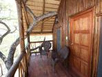 Relax on on the verandah of a tree house