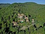 Aerial view of the borgo immersed in the hills of Chianti