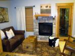 Cozy sitting room off kitchen. A great place to relax by the fire. Access to deck and grill.