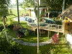 Pool, Pavillion and Bedrooms with bridge decorated for Christmas