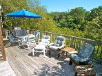 The deck has this handy table and chairs for outdoor dining and plenty of comfy seating to enjoy the peek at the Bay
