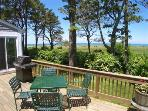 Chill, grill and enjoy the 180-degree vista of the East Brewster marshes, Crosby Landing Beach and sunsets over Cape...
