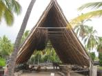 Part of reconstructed old Hawaiian village at Place of Refuge National Park 30 minutes drive south