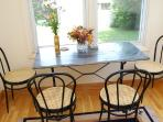 The breakfast nook. Enjoy your morning coffee looking out over the garden.